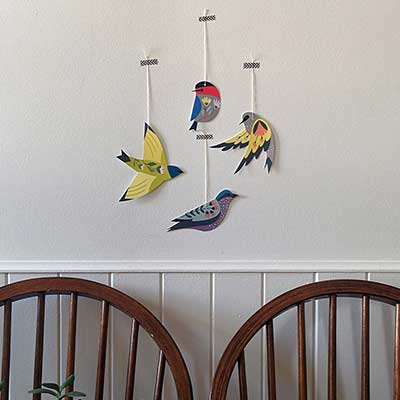 decorative birds hanging on wall