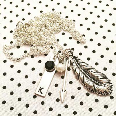 silver necklace with feather and arrow