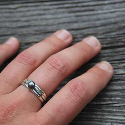 hand wearing handmade silver ring
