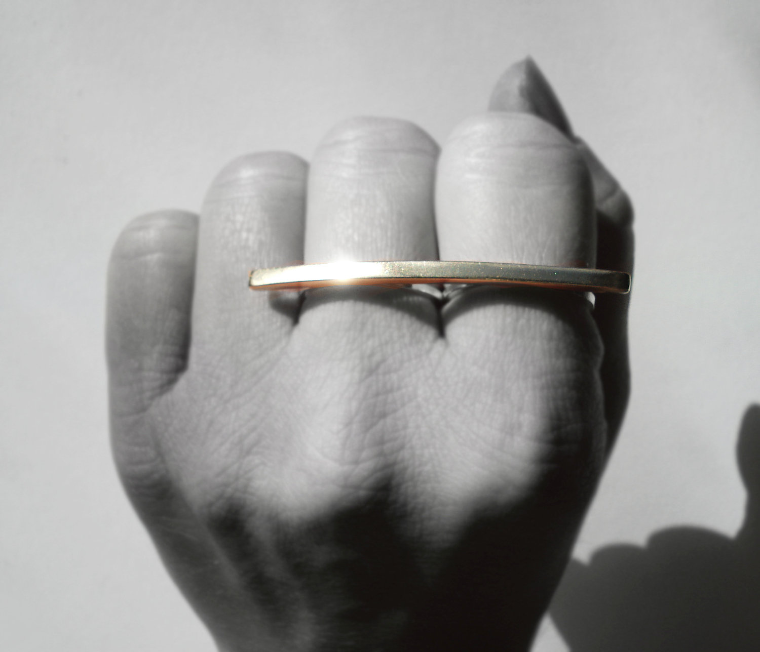 fist with double gold ring