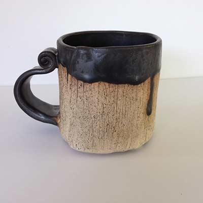 handmade pottery beige mug with black handle
