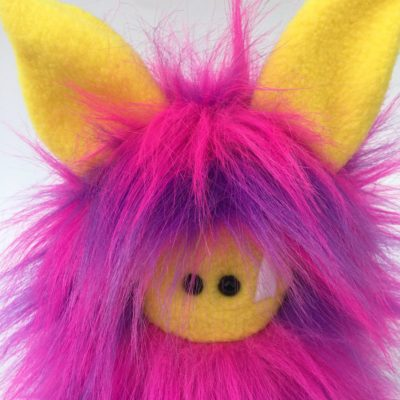 colourful pink monster stuffed animal