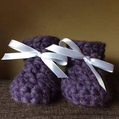 pair of hand knitted baby slippers