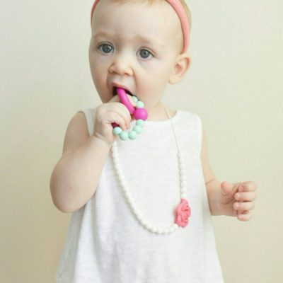 baby with chewable bracelet