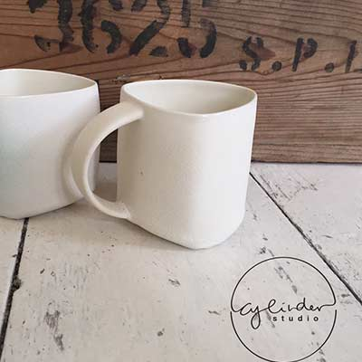 beige pair of handmade mugs